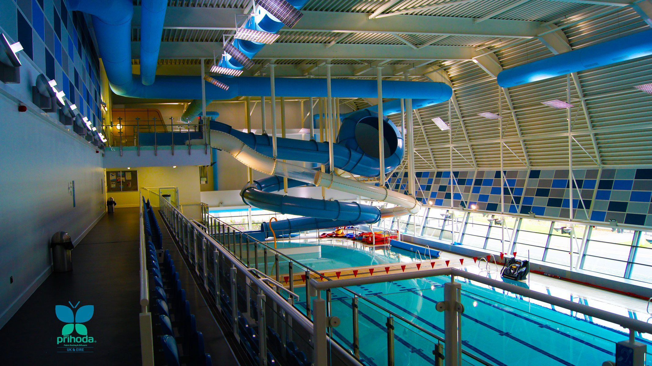 blue ducting in large swimming pool area