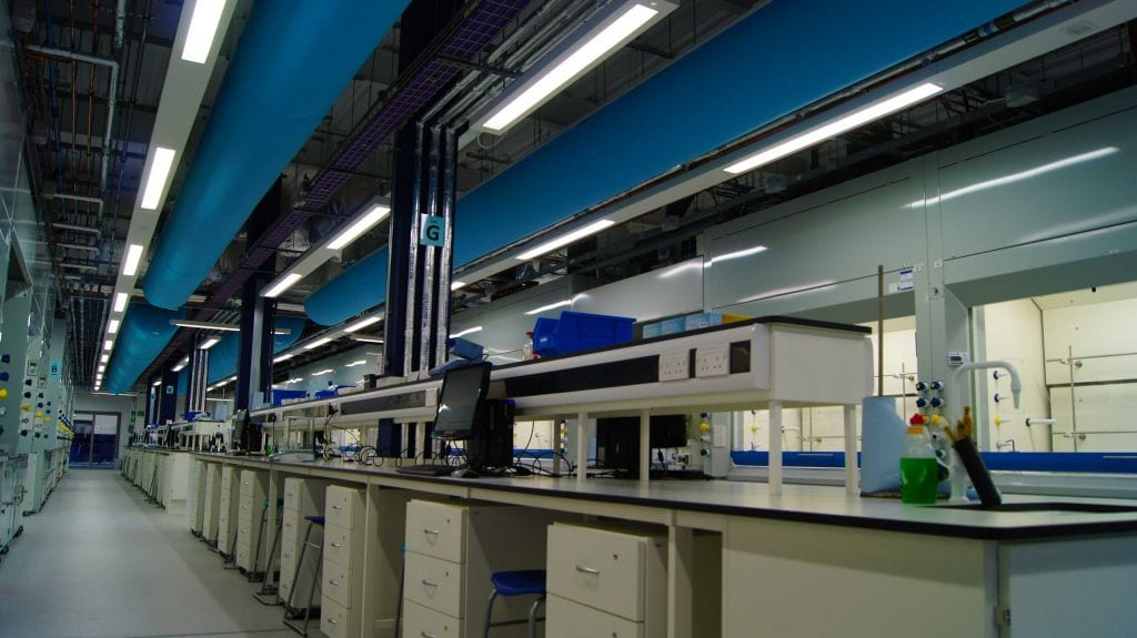 multiple fabric ducts in laboratory of university of york showing long row of work stations
