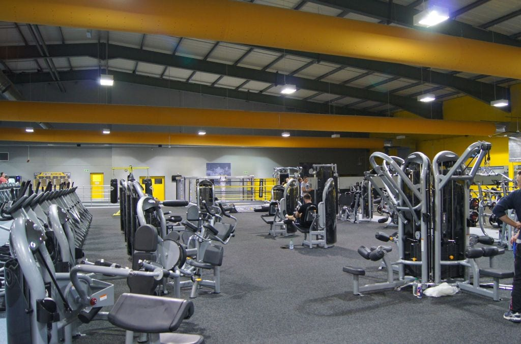 multiple fabric ducts looking across workout area of gym