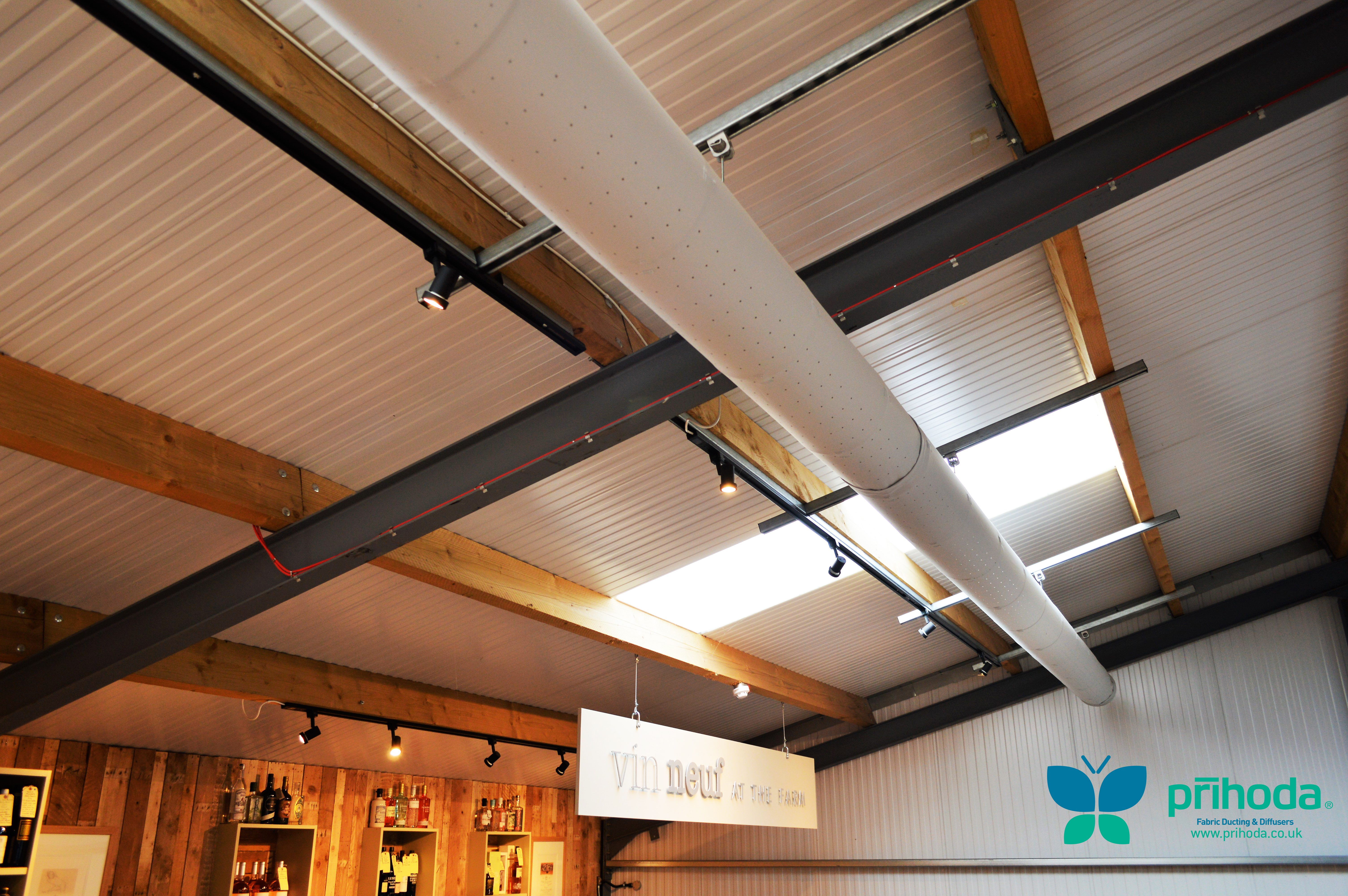 retail building ceiling with fabric ducting at The Farm