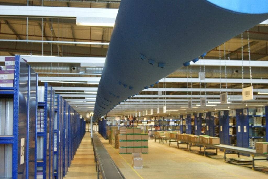 blue fabric duct in a warehouse