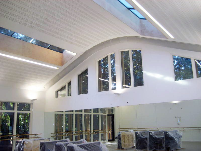 Exposed ductwork: fabric ducts follow the curved profile of the ceiling.