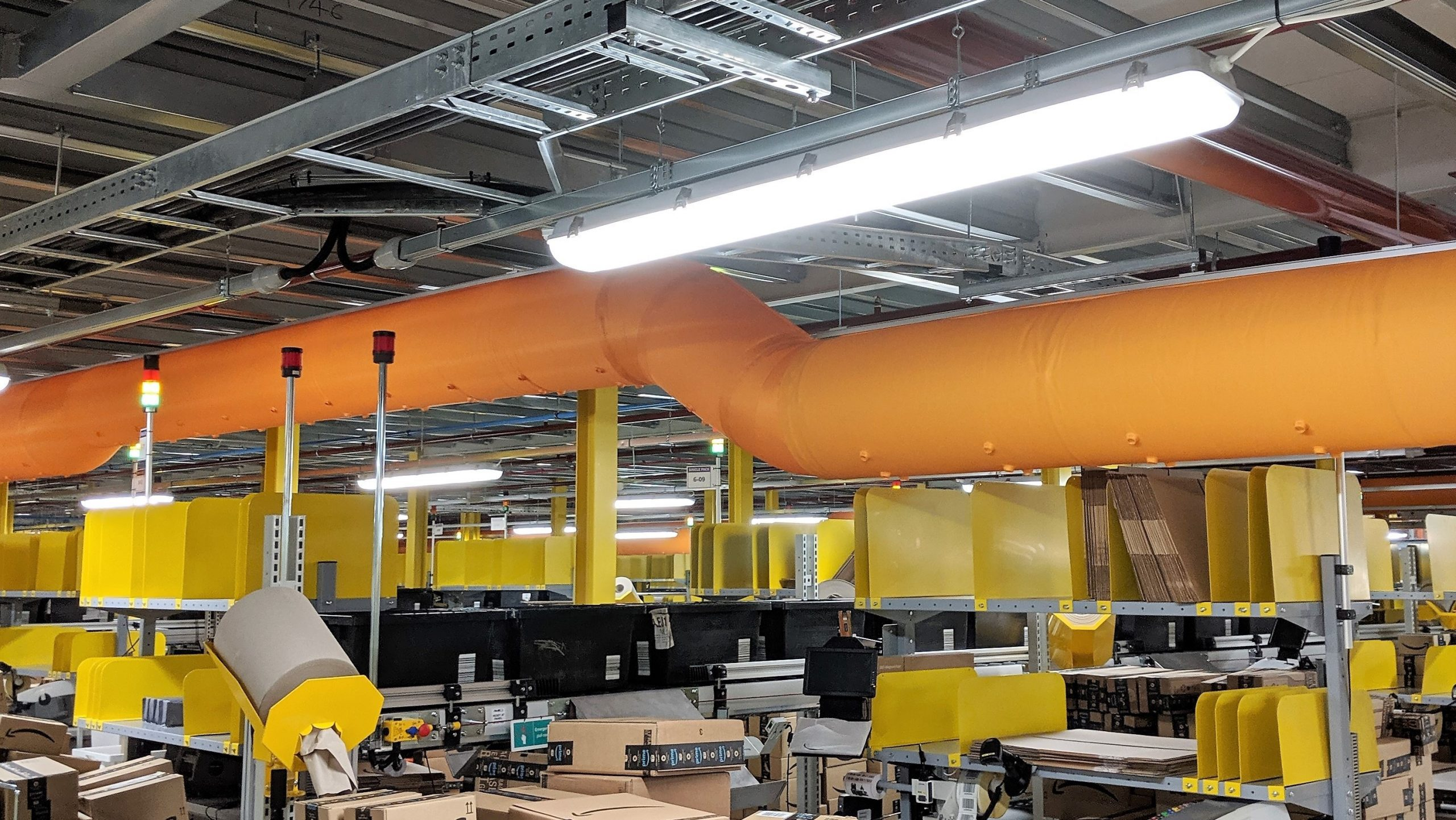 Orange fabric duct with nozzles and 45 degree bend