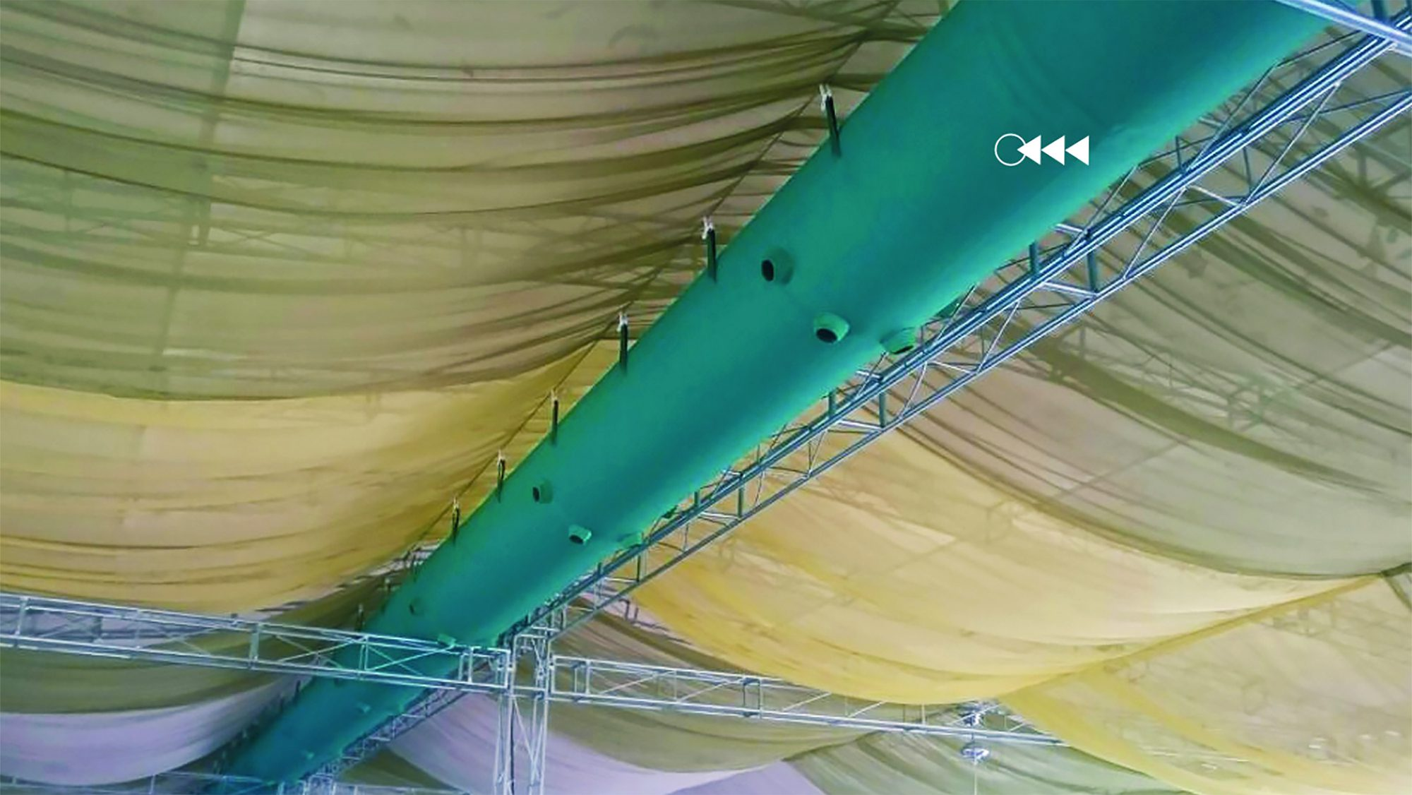 turquoise fabric ducts in a marquee