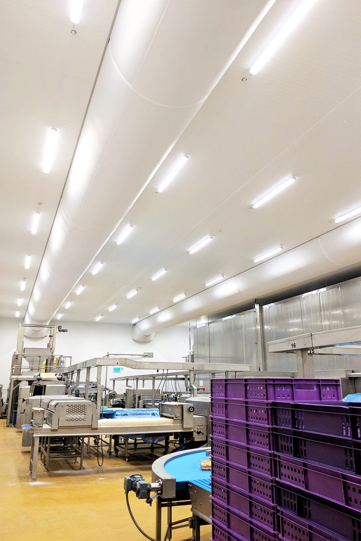White fabric diffusers in a food production facility