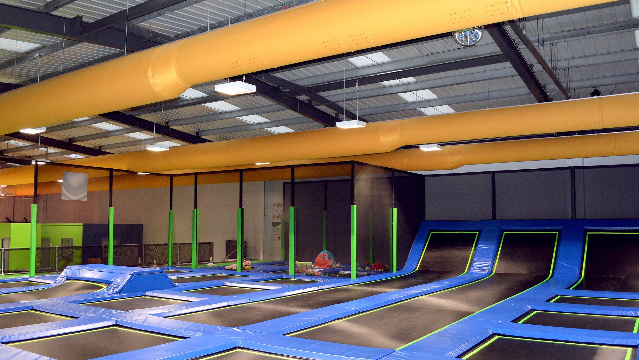 Fabric ducting in a trampoline park