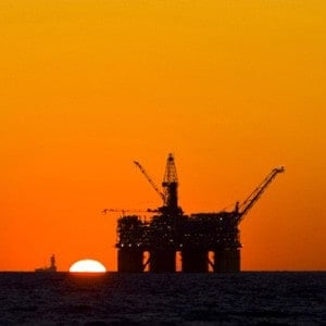 An image of a oil rig at sea